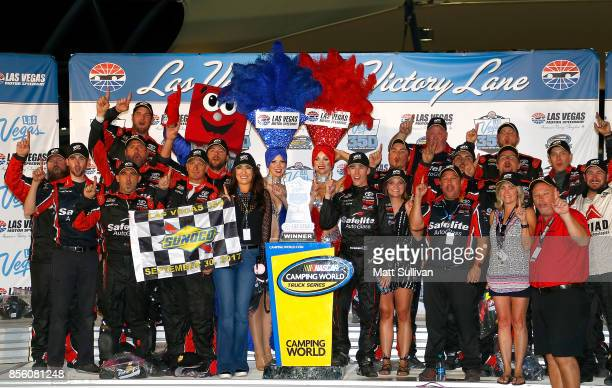 Ben Rhodes driver of the Safelite Auto Glass Toyota celebrates in victory lane with the trophy after winning the NASCAR Camping World Truck Series...