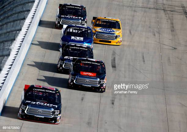 Ben Rhodes driver of the Safelite Auto Glass Toyota leads a pack of trucks during the NASCAR Camping World Truck Series Bar Harbor 200 presented by...