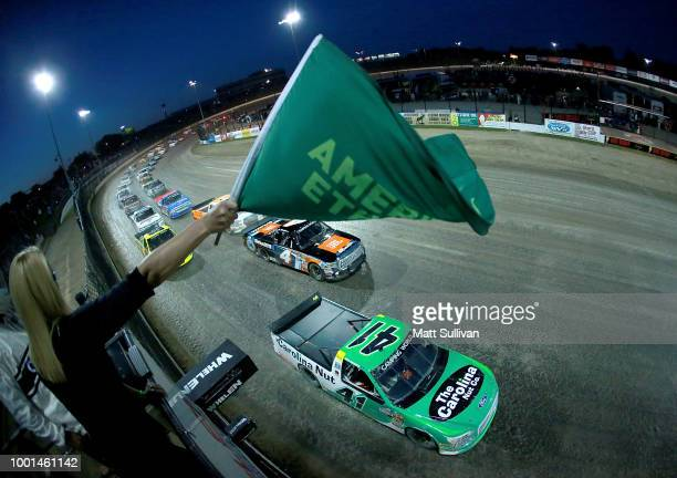 Chase Briscoe driver of the Ford Ford celebrates with the checkered flag after winning the NASCAR Camping World Truck Series Eldora Dirt Derby at...
