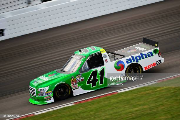 Ben Rhodes driver of the ThirSport Racing Fordduring practice for the NASCAR Camping World Truck Series Villa Lighting delivers the Eaton 200 at...