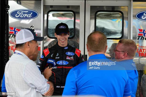 Ben Rhodes driver of the ThorSport Racing Ford talks with the media during a rain delay prior to the start of practice for the NASCAR Camping World...