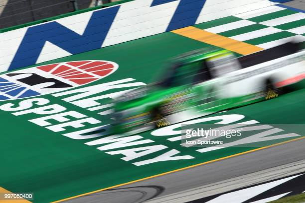 Ben Rhodes ThorSport Racing Ford F150 is a blur as he crosses the start/finish line during practice for the NASCAR Camping World Truck Series Buckle...