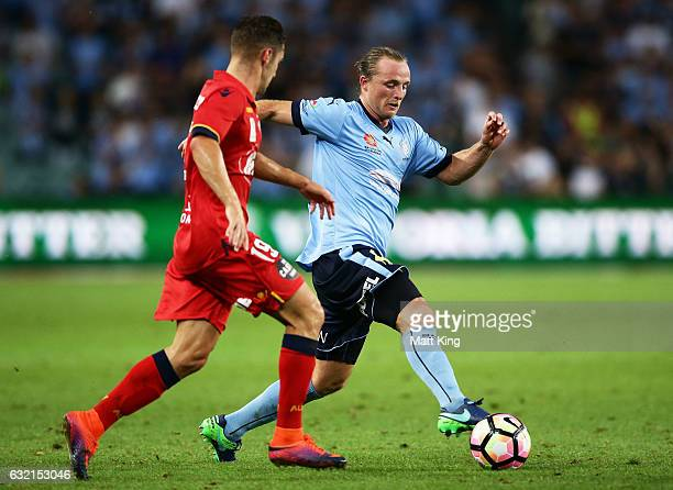 Ben Rhyan Grant of Sydney FC is challenged by Garuccio of United during the round 16 ALeague match between Sydney FC and Adelaide United at Allianz...