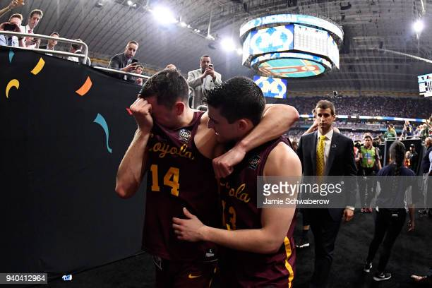 Ben Richardson and Clayton Custer of the Loyola Ramblersembrace in tears after their team's l;oss to Michigan Wolverines in the 2018 NCAA Photos via...