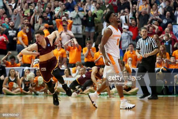Ben Richardson of the Loyola Ramblers and Jordan Bone of the Tennessee Volunteers react after the Loyola Ramblers beat the Tennessee Volunteers 6362...
