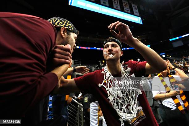 Ben Richardson of the Loyola Ramblers celebrates after defeating the Kansas State Wildcats during the 2018 NCAA Men's Basketball Tournament South...