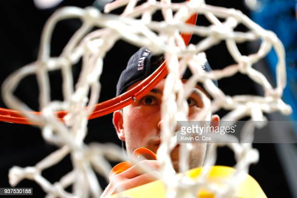 Ben Richardson of the Loyola Ramblers celebrates by cutting down the net after defeating the Kansas State Wildcats during the 2018 NCAA Men's...