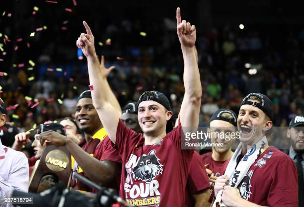 Ben Richardson of the Loyola Ramblers celebrates with teammates after defeating the Kansas State Wildcats during the 2018 NCAA Men's Basketball...