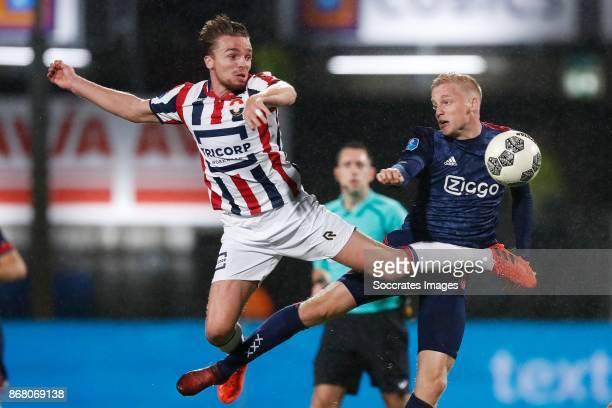 Ben Rienstra of Willem II Donny van de Beek of Ajax during the Dutch Eredivisie match between Willem II v Ajax at the Koning Willem II Stadium on...