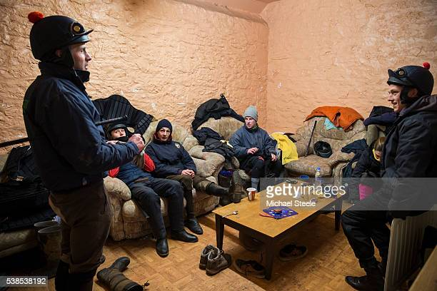 Ben Robarts in conversation with fellow staff during a break at Sandhill Racing Stables on January 20 2016 in Minehead England Sandhill Racing...