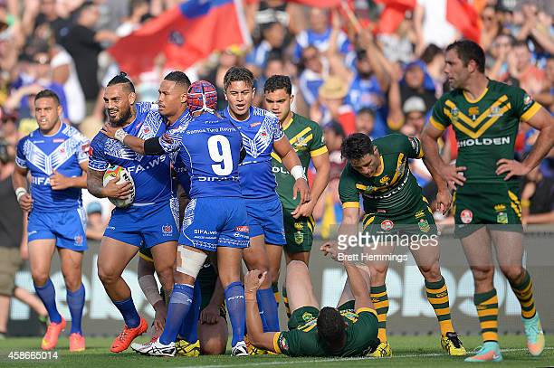 Ben Roberts of Samoa celebrates scoring a try with team mates during the Four Nations match between the Australian Kangaroos and Samoa at WIN Stadium...