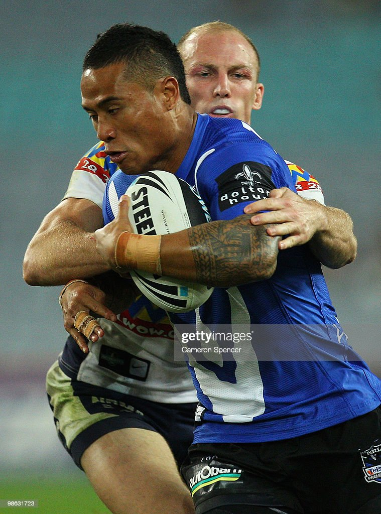Ben Roberts of the Bulldogs is tackled by Darren Lockyer of the Broncos during the round seven NRL match between the Canterbury Bulldogs and the Brisbane Broncos at ANZ Stadium on April 23, 2010 in Sydney, Australia.
