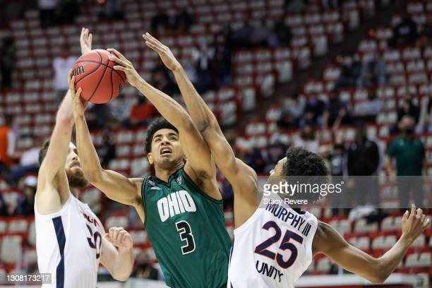 Ben Roderick of the Ohio Bobcats looks to shoot defended by Trey Murphy III of the Virginia Cavaliers in the first round game of the 2021 NCAA Men's...