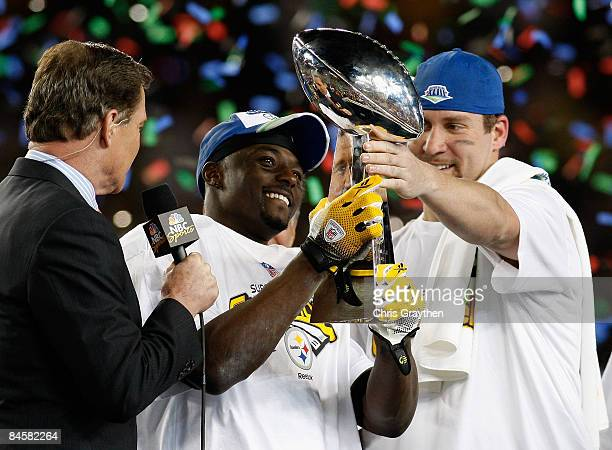 Ben Roethlisberger hand Santonio Holmes of the Pittsburgh Steelers the trophy after the Steelers won 2723 against the Arizona Cardinals during Super...