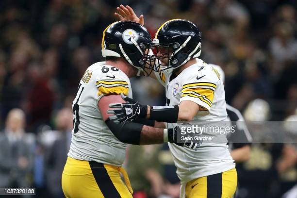 Ben Roethlisberger of the Pittsburgh Steelers and David DeCastro of the Pittsburgh Steelers react after scoring a touchdown during a game against the...