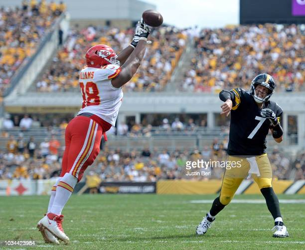 Ben Roethlisberger of the Pittsburgh Steelers attempts a pass under pressure from Xavier Williams of the Kansas City Chiefs in the first half during...