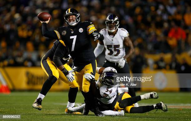 Ben Roethlisberger of the Pittsburgh Steelers attempts a throw under pressure from Tyus Bowser of the Baltimore Ravens in the fourth quarter during...