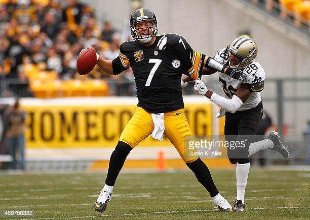 Ben Roethlisberger of the Pittsburgh Steelers avoids a tackle by Keenan Lewis of the New Orleans Saints during the first quarter at Heinz Field on...