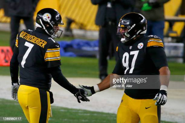 Ben Roethlisberger of the Pittsburgh Steelers celebrates with teammate Cameron Heyward following a touchdown pass during the second quarter of their...
