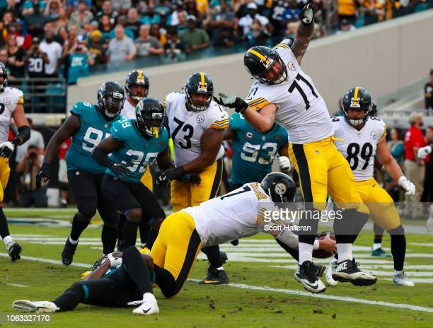 Ben Roethlisberger of the Pittsburgh Steelers dives for the goahead touchdown during the second half against the Jacksonville Jaguars at TIAA Bank...