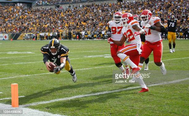 Ben Roethlisberger of the Pittsburgh Steelers dives into the end zone for a 3 yard touchdown in the fourth quarter during the game against the Kansas...