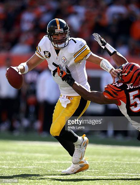 Ben Roethlisberger of the Pittsburgh Steelers fends off the pressure of Landon Johnson of the Cincinnati Bengals during the NFL game on October 28...
