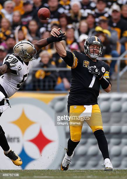 Ben Roethlisberger of the Pittsburgh Steelers gets hit by Curtis Lofton of the New Orleans Saints during the second quarter at Heinz Field on...