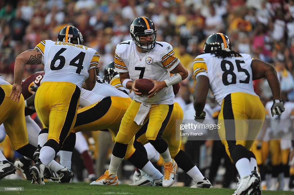 Ben Roethlisberger #7 of the Pittsburgh Steelers hands off against the Washington Redskins at FedExField on August 12, 2011 in Landover, Maryland. The Redskins defeated the Steelers 16-7 at the half.
