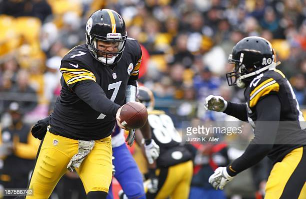 Ben Roethlisberger of the Pittsburgh Steelers hands off to Felix Jones during the game against the Buffalo Bills on November 10 2013 at Heinz Field...