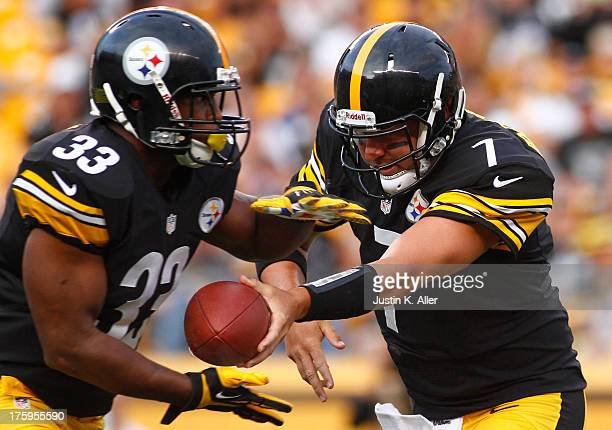 Ben Roethlisberger of the Pittsburgh Steelers hands off to Isaac Redman against the New York Giants during the game on August 10 2013 at Heinz Field...