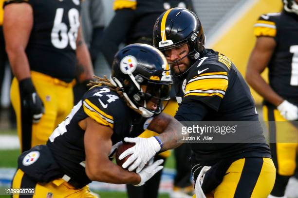 Ben Roethlisberger of the Pittsburgh Steelers hands the ball to teammate Benny Snell Jr. #24 during warm-ups prior to their game against the...