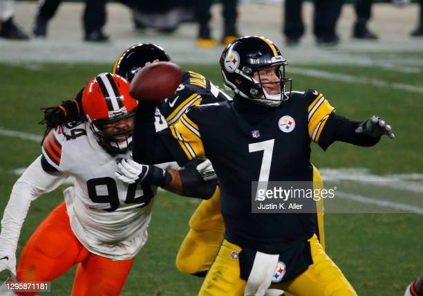 Ben Roethlisberger of the Pittsburgh Steelers in action against Adrian Clayborn of the Cleveland Browns on January 11, 2021 at Heinz Field in...