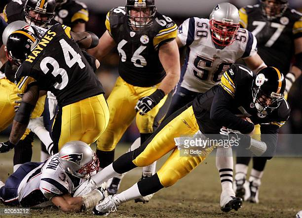 Ben Roethlisberger of the Pittsburgh Steelers is brought down by Rodney Harrison of the New England Patriots in the AFC championship game at Heinz...