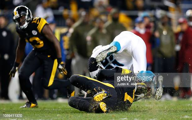 Ben Roethlisberger of the Pittsburgh Steelers is hit by Eric Reid of the Carolina Panthers as he slides during the third quarter in the game at Heinz...