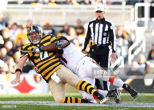 Ben Roethlisberger of the Pittsburgh Steelers is sacked by Michael Johnson of the Cincinnati Bengals during the 2nd quarter of the game at Heinz...