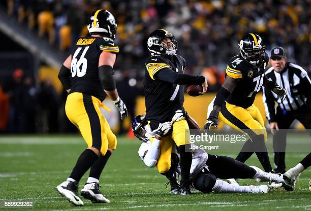 Ben Roethlisberger of the Pittsburgh Steelers is sacked by Tyus Bowser of the Baltimore Ravens in the second quarter during the game at Heinz Field...