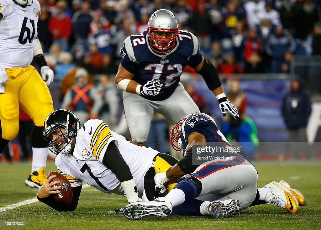 Ben Roethlisberger #7 of the Pittsburgh Steelers is sacked in the fourth quarter by Andrew Carter #96 of the New England Patriots at Gillette Stadium on November 3, 2013 in Foxboro, Massachusetts.