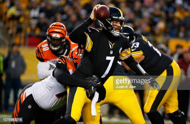 Ben Roethlisberger of the Pittsburgh Steelers is wrapped up for a sack by Christian Ringo of the Cincinnati Bengals in the first half during the game...