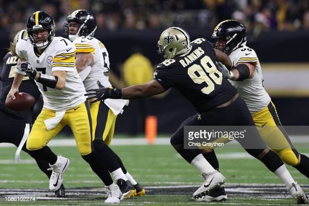 Ben Roethlisberger of the Pittsburgh Steelers runs with the ball as Sheldon Rankins of the New Orleans Saints defends during the first half at the...
