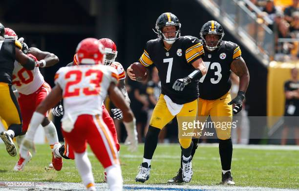 Ben Roethlisberger of the Pittsburgh Steelers scrambles out of the pocket in the first half during the game against the Kansas City Chiefs at Heinz...
