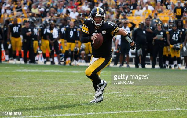 Ben Roethlisberger of the Pittsburgh Steelers scrambles out of the pocket in the fourth quarter during the game against the Kansas City Chiefs at...