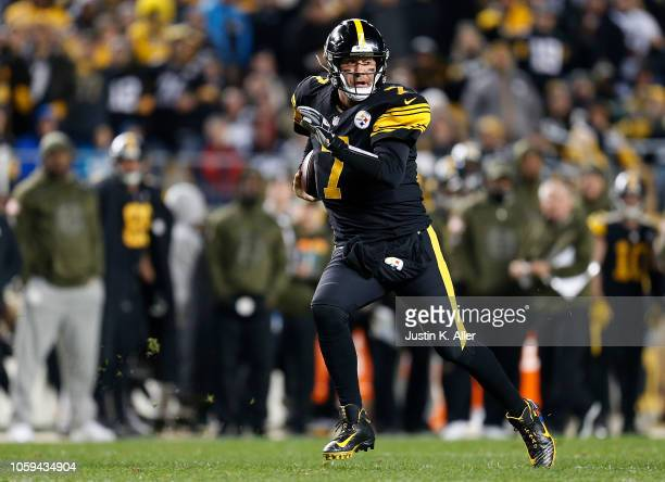 Ben Roethlisberger of the Pittsburgh Steelers scrambles out of the pocket during the third quarter in the game against the Carolina Panthers at Heinz...