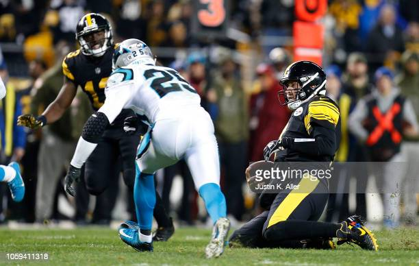 Ben Roethlisberger of the Pittsburgh Steelers slides after running upfield during the third quarter in the game against the Carolina Panthers at...