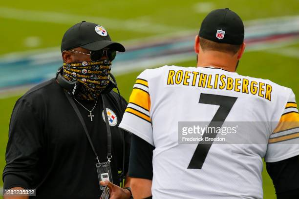 Ben Roethlisberger of the Pittsburgh Steelers speaks to his coach Mike Tomlin on the sideline during a game against the Tennessee Titans at Nissan...