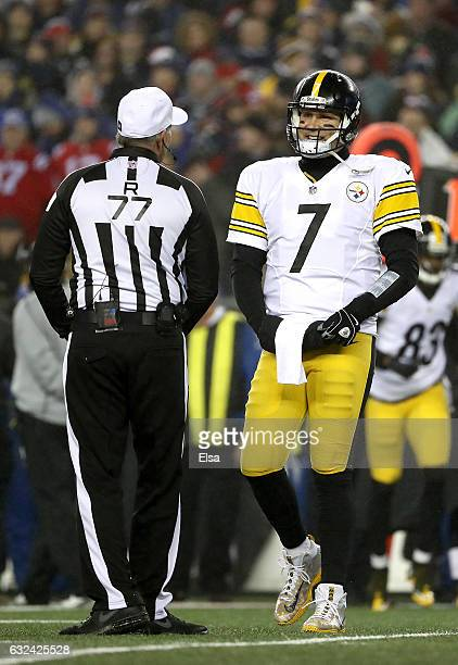 Ben Roethlisberger of the Pittsburgh Steelers speaks with referee Terry McAulay during the first quarter against the New England Patriots in the AFC...