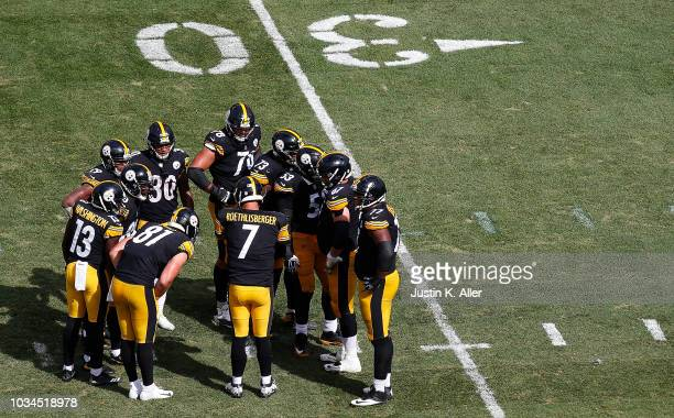 Ben Roethlisberger of the Pittsburgh Steelers talks to teammates in the huddle in the second half during the game against the Kansas City Chiefs at...