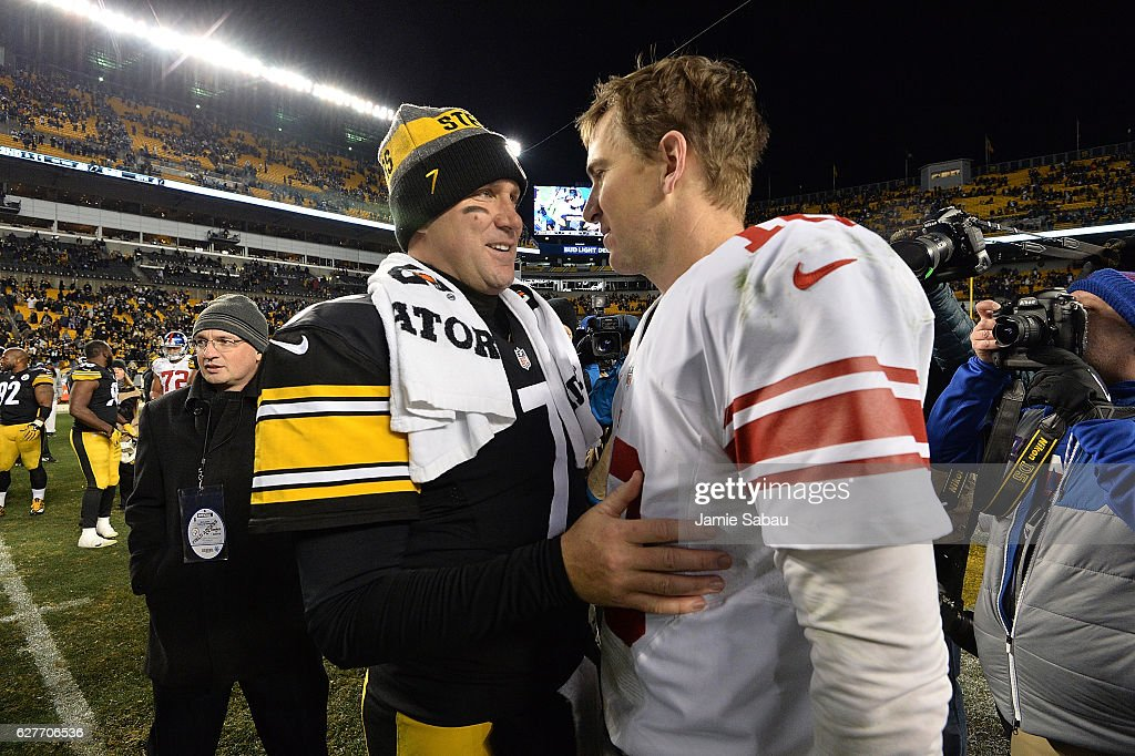 Ben Roethlisberger #7 of the Pittsburgh Steelers talks with Eli Manning #10 of the New York Giants at the conclusion of the Pittsburgh Steelers 24-14 win over the New York Giants at Heinz Field on December 4, 2016 in Pittsburgh, Pennsylvania.