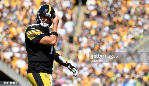 Ben Roethlisberger of the Pittsburgh Steelers walks onto the field in the first quarter during the game against the Seattle Seahawks at Heinz Field...