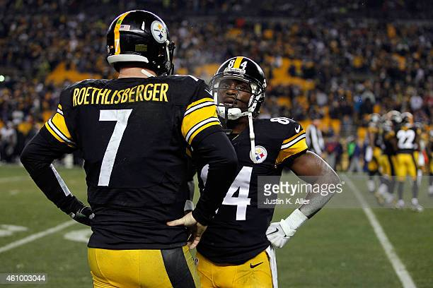 Ben Roethlisberger speaks with Antonio Brown of the Pittsburgh Steelers on the bench in the fourth quarter against the Baltimore Ravens during their...