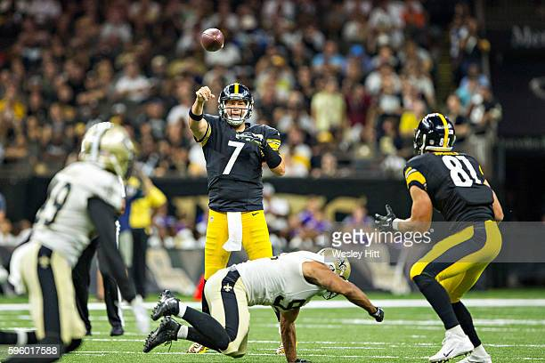 Ben Roethlisberger throws a pass to Jesse James of the Pittsburgh Steelers during a preseason game against the Pittsburgh Steelers at Mercedes-Benz...